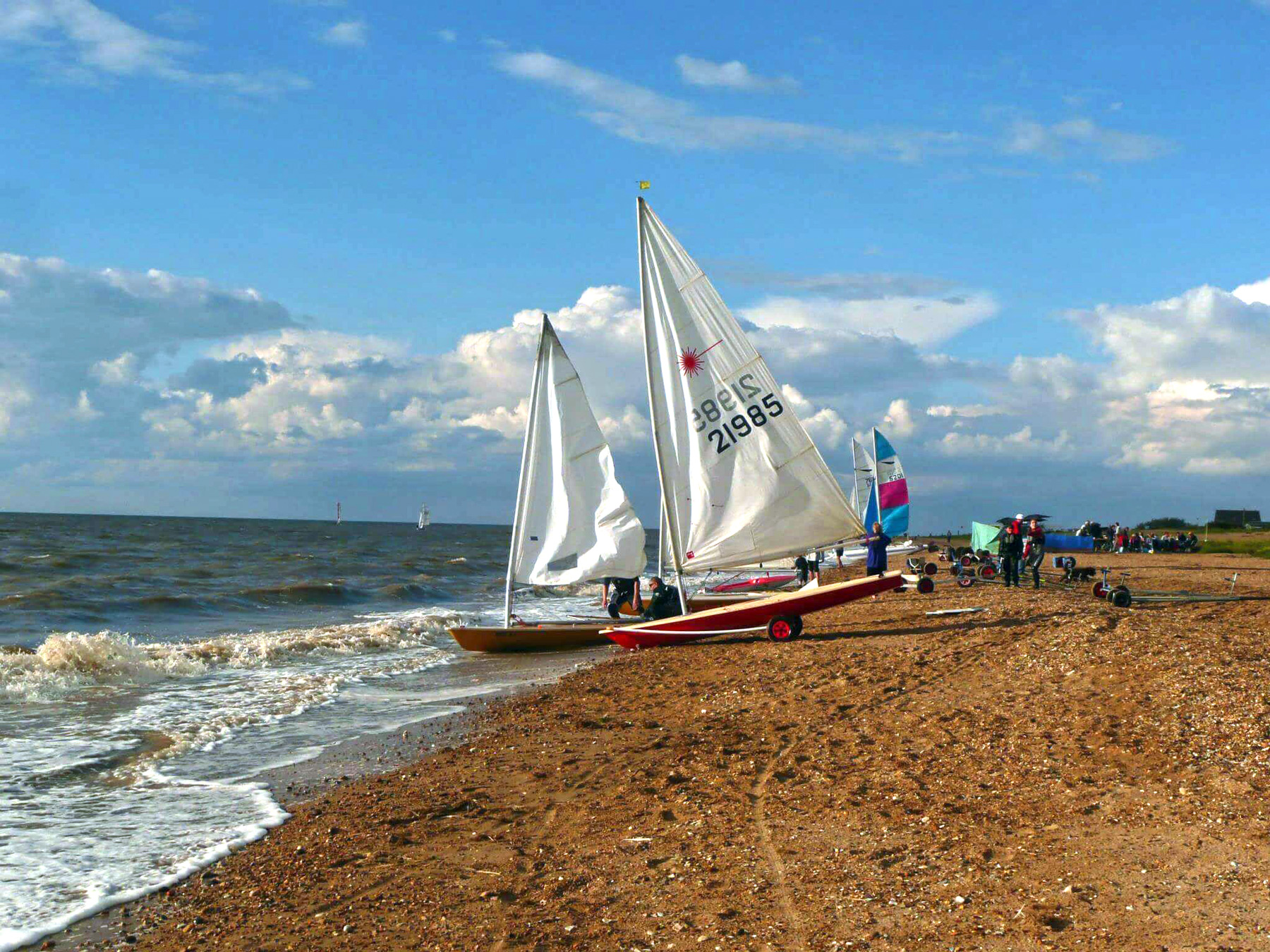 Laser sailing dingy boats on Snettisham beach